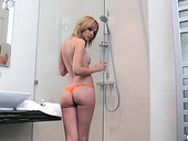 Nikita is taking shower and showing off her sweet teen ass and kitty