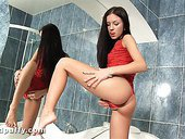 Young brunette Sasha Rose masturbates in the bathroom