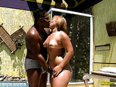 Bootyful black milf gives a head to oversized black dick