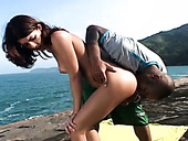 Kinky black haired filth gonna get her pussy licked right on the beach
