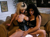 Busty lesbo in corset Dora B gets busy with tickling the chick's wet cunt
