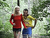 Skinny blond girl flashes her tits in the woods