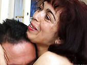 Arousing Latin mature gives a blowjob to aroused young BF
