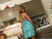 Redhead MILF Laura sucks sausage in the kitchen