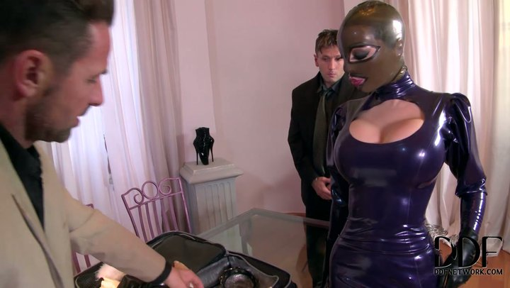 Busty babe in latex gets  fucked hard by two guys