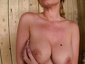 Green-eyed enchantress with big yummy tits plays with herself