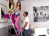 Lucky repairman receiving a double footjob from two sexy chicks