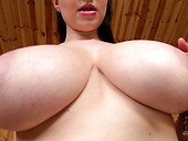 Busty mommy rubs her jugs with oil squeezing them hard