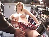 Pallid blond haired nympho Alex Devine wanders in the shop topless