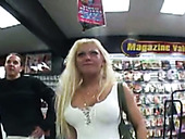 Whorable blondie Diamond pulls up white dress and tickles fancy in sex shop