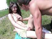 Cuddly girl Aimee is having passionate foreplay in the public park