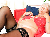 Nasty granny in stockings opens wide her hairy pink pussy