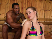 Nasty blonde gives slobbery blowjob to one big black guy in the sauna