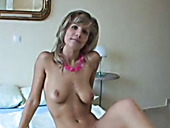 Smiling blondie with droopy tits goes solo and fingerfucks her wet pussy