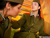Two army chicks undress each other and kiss passionately