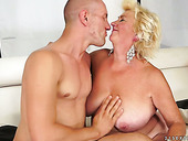 Horny old fatso with droopy boobs rides a dick and gives a titfuck for cum