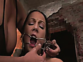 Pretty girl is getting her mouth fucked with huge dildo while her hands and legs are tied up. BDSM