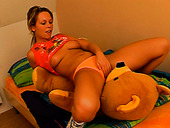 Naughty and playful teen rides her favorite toy on the bed