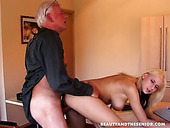 Bending over the table busty blonde Sasha gets poked by fat old Johan
