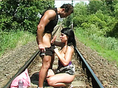 Big breasted brunette gives her lover a blowjob on the railway road
