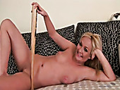 Talented MILF porn actress stuffs her cunt with baseball bat