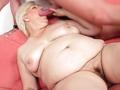 Fat old granny is getting toy fucked on a couch with big dildo