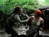 Two hot redhead and brunette bitches have a catfight in mud