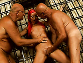 Slender tall redhead gets fixed with ropes and sucks two dicks for cum