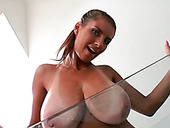 Buxom stunner squeezes her big natural boobs showing off her goodies
