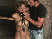 Ruined brunette MILF gets her mouth plugged sex toy in BDSM sex clip