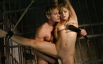 Busty blondie gets her pussy spanked with a leather paddle