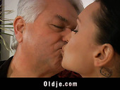 Alluring young brunette jerks off dick and rides old dude reverse