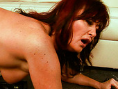 Shabby brunette mature gets banged with dildo machine