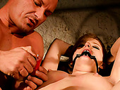 Perverted dude is dripping hot drops of wax on tied up hooker