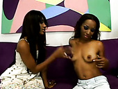 Two steamy black lesbians dildo fuck each other's soaking mufs