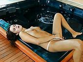 Amateur brunette swetie masturbates pussy near the pool
