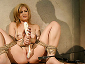 Horn-mad dude puts a gag into tied up blondie's mouth and teases her cunt