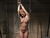 Tasty looking blonde gets hanged to the ceiling with chain in BDSM sex scene