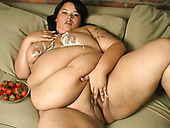 Chunky BBW slut eats strawberry with cream and masturbates on a couch