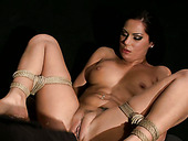 Lewd girl is screwed missionary style while being tied up in BDSM porn clip