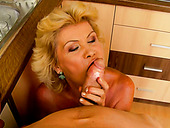 Blond mommy sucked a large cock of her friend