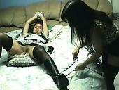 Beautiful girl Cinnamon is getting poked with strapon while tied up to the bed