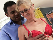 Four eyed granny sucks a huge black cock like crazy
