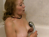 Bodacious granny fingers her wet pussy in the bathroom