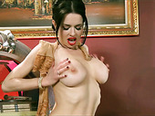 Alluring brunette oils up her big boobs and gets her pussy polished