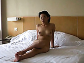 Bosomy Asian hooker presents hard BJ to her kinky man