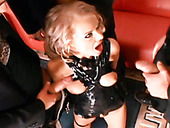 Three well endowed studs fuck one lustful chick wearing latex lingerie