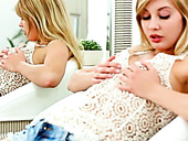 Cute blonde teeny caresses her sexy while looking at her reflection