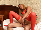 Fair haired shemale hottie in red stockings gets anal attacked in sideways style