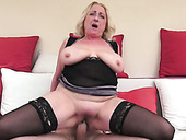 Ugly mature blonde in stockings rides young dude face to face